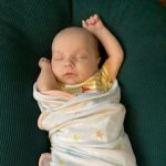 Baby save Tasman sleeps in a swaddle blanket
