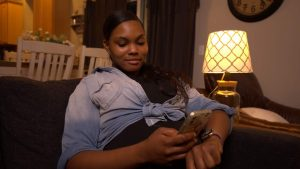 An expectant mom counts kicks on her phone using the free Count the Kicks app.